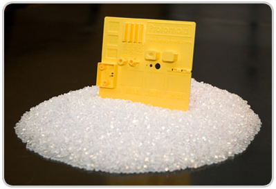Fig. 1 - Corn-based Biodegradable resin pellets used for injection molding to create plast parts.