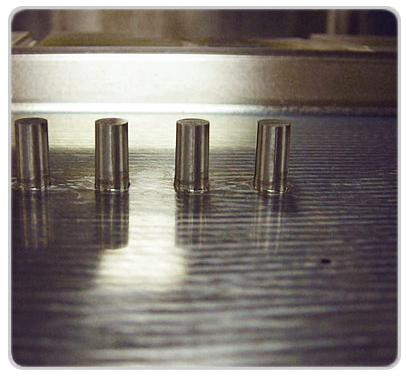 Mold with cylindrical steel core pins for part